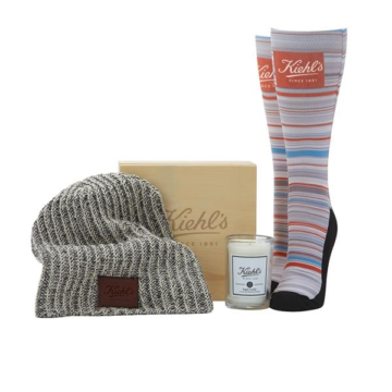 Get your brand in their hands even in a blizzard! This incredible Snowed In Gift Set will keep clients cozy during harsh winter storms and their eyes on your brand. With this awesome gift set clients will be able to snuggle up in a soft knitted beanie decorated with a debossed leather patch, premium socks to keep toes warm, and an 8 oz. glass tumbler candle with a variety of scents to choose from. Each item in this set can be customized with a logo, message, symbol, marketing design, or promotional artwork. Warm up new clientele to your brand with this cozy gift set! Deboss imprint on beanie. Full color label candle. Laser engraving on wood box. Dye-Sublimated socks.